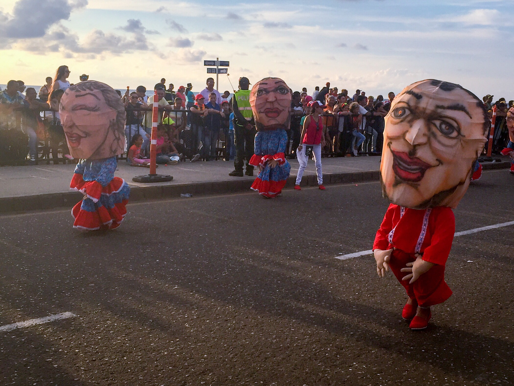 Little people with large heads bobbing on down the road.