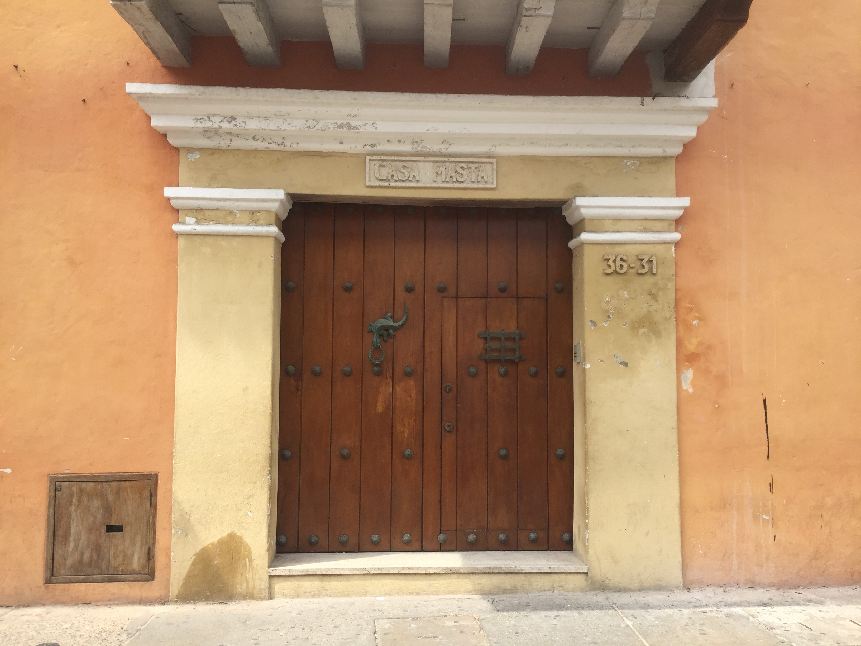 Many buildings had large wooden doors with smaller doors built inside and large knockers.