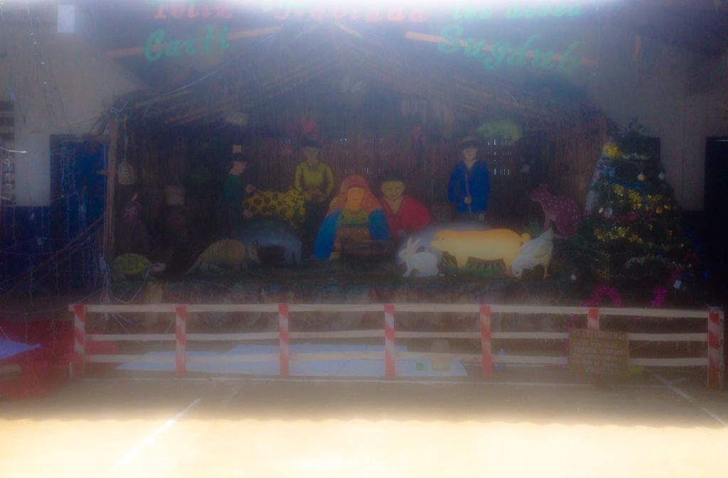 Life size nativity set in the center of the island.
