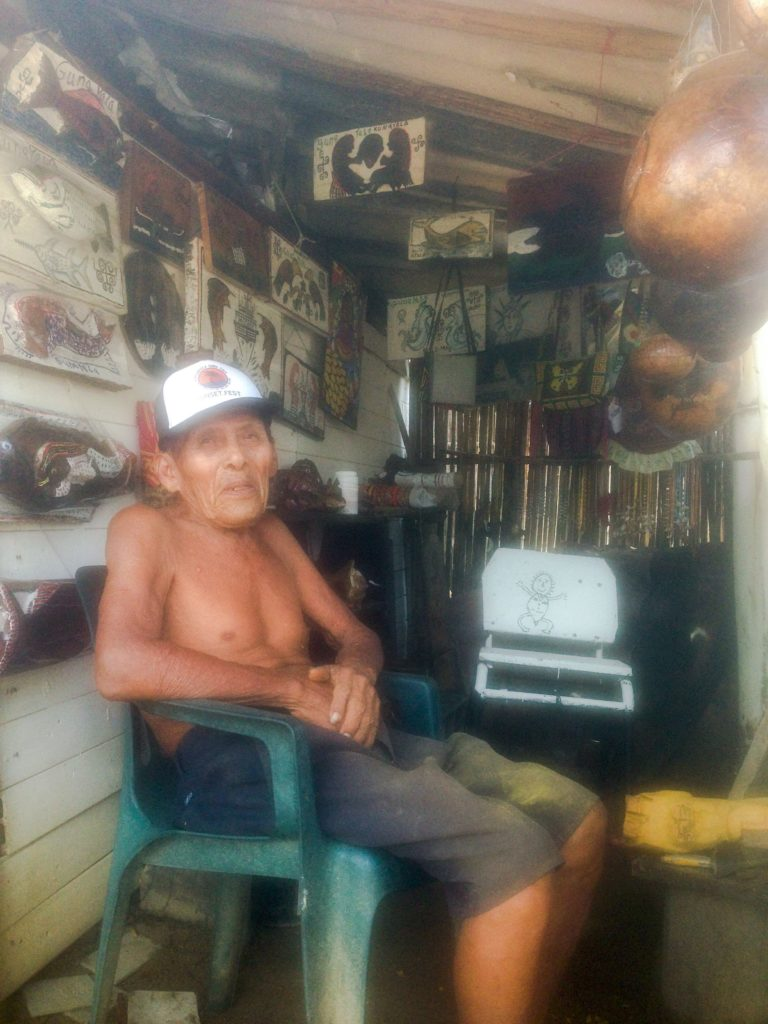 Sweet Kuna man carving wood