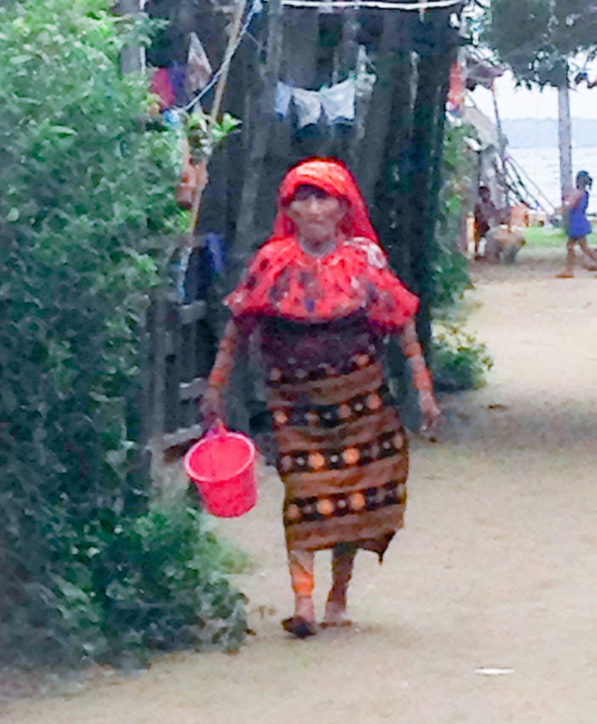 Kuna woman walking in standard outfit for women
