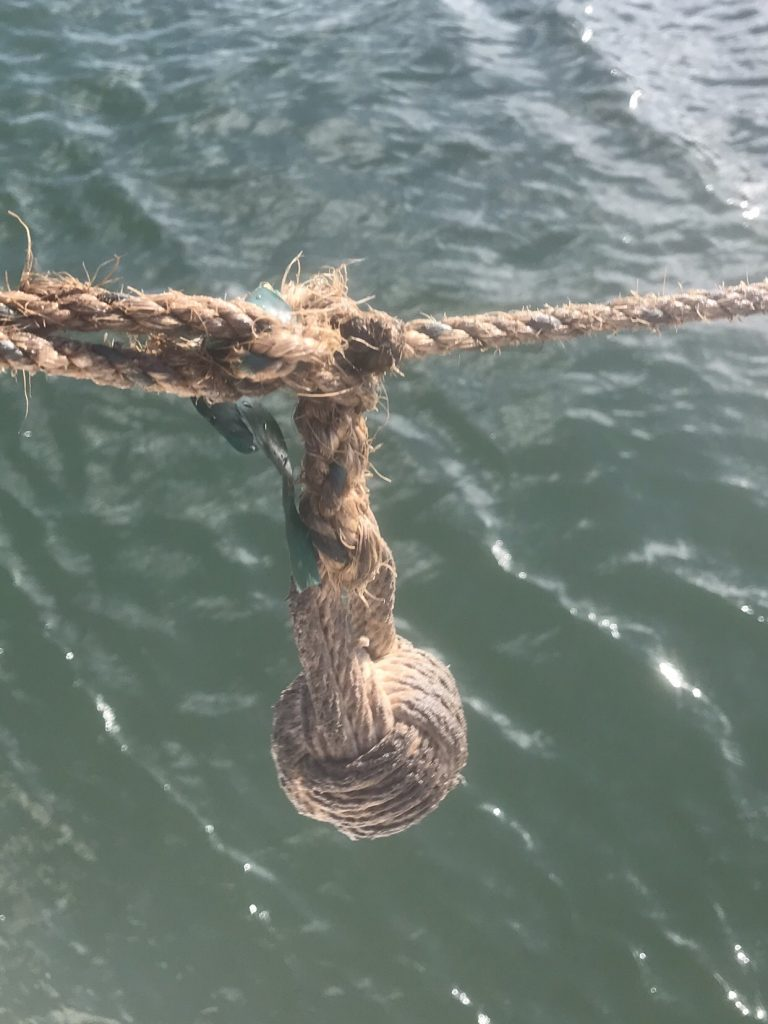 Monkey fist thrown to boat to retrieve blue lines