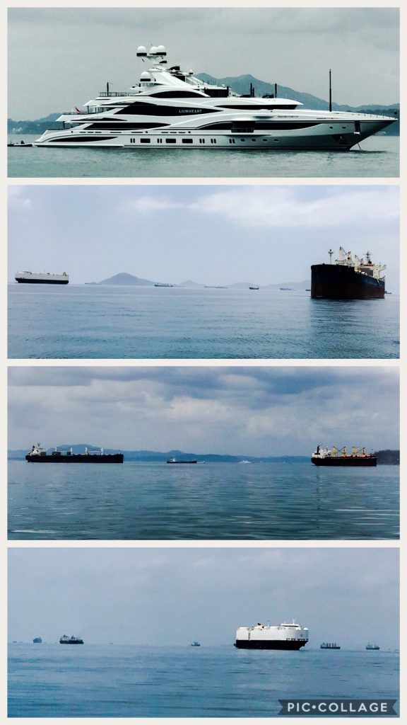 Large cargo ships & yachts in La Playita anchorage.