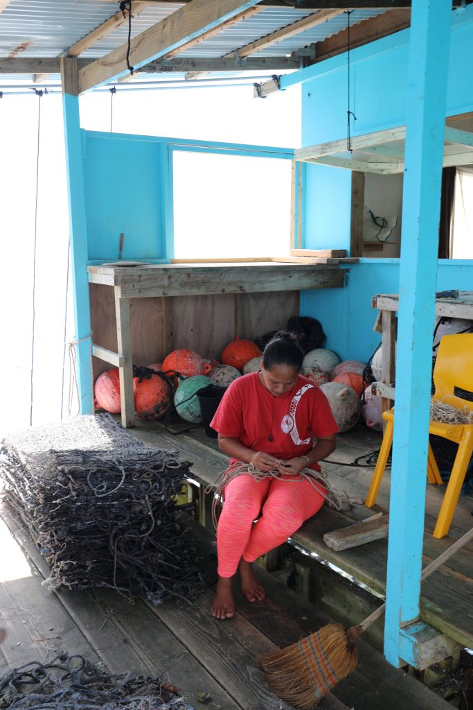 Working on nets for pearl harvesting